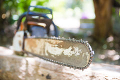 Old chainsaw on the stump Royalty Free Stock Photo