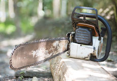 Old chainsaw on the stump Royalty Free Stock Images