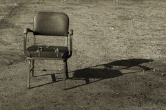 Old Chair. Toned old chair alone in dirt Stock Images