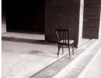 Old chair. The old lonely broken chair Stock Photography