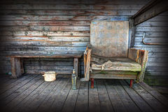 Old chair on the background of wooden wall. Stock Photos