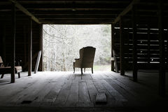Old chair in barn. Old armchair in a barn royalty free stock images