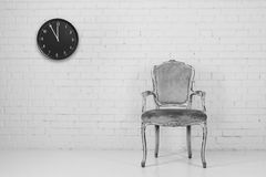 Old chair with clock Stock Photos