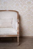 Old chair close-up. On a background of vintage wall Stock Photo