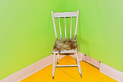 Old chair in the corner. Stock Images