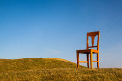 The old chair on the golf course Royalty Free Stock Photos