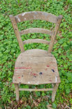 Old Chair on the Grass Royalty Free Stock Images