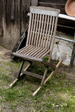 Old chair and guitar in garden Royalty Free Stock Photo