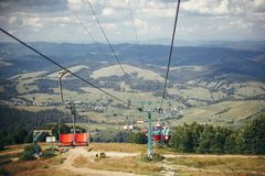 Old chair lift hoist and beautiful landscape of mountains hill. royalty free stock image