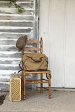 Old chair with rustic canvas bag and suitcase Royalty Free Stock Photo