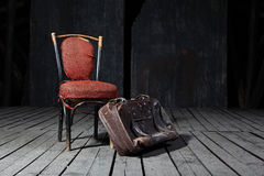 Old chair and suitcase Royalty Free Stock Image