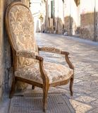 Old chair in a traditional street of Lecce, Italy. Stock Photography