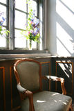 Old chair by window Royalty Free Stock Image