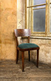 Old chair by the window Royalty Free Stock Photography