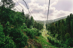 Old chairlift hoist in sunny summer mountains under blue sky and Royalty Free Stock Image