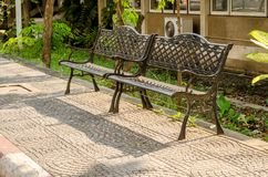 Old Chairs steel Bench in the garden Royalty Free Stock Photo