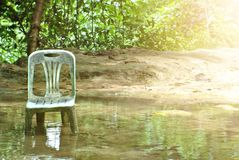 Old chairs in the stream with sunlight royalty free stock photos