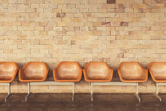 Old chairs with yellow brick wall background. Stock Images