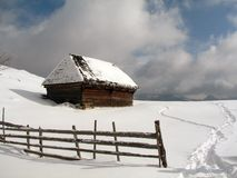 Old chalet in winter. Old wood house in winter, blue sky, white snow Stock Photography