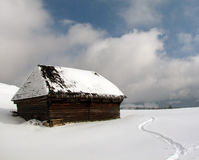 Old chalet in winter stock images