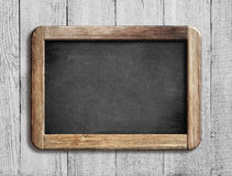 Old chalkboard or blackboard on white wood Stock Photography