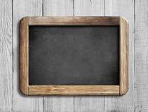 Old chalkboard or blackboard on white wood Stock Photography