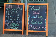 Old chalkboard menus outside restaurant Stock Photos
