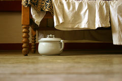 Old chamberpot. On a wood floor Stock Image