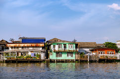 Old Chao Phraya River Thai traditional houses. Village riverfront in Bangkok Thailand Royalty Free Stock Image