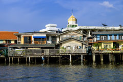 Old Chao Phraya River Thai traditional houses. Village riverfront in Bangkok Thailand Royalty Free Stock Images
