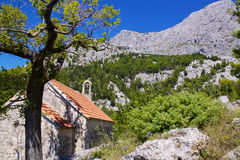 Old chapel. Old stone chapel near village of Tucepi below towering mountains of Biakovo nature park on Makarska Riviera in Dalmatia, Croatia Stock Photography