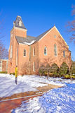 Old chapel on a college campus in winter vertical Royalty Free Stock Image