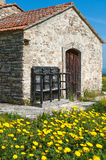 Old chapel, cyprus. An old chapel in the mountain village of lefkara surrounded by yellow daises Stock Photos