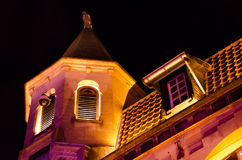 Old chapel in Dutch street at night. Lit by colorful reflectors, Valkenburg, Netherlands Royalty Free Stock Photography