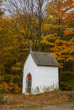 Old chapel in fall forest Royalty Free Stock Photos