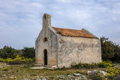 Old chapel near Plat on Cres, Croatia. On a cloudy day in spring Stock Image