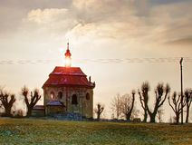 Old chapel with renewal roof on the hill. Old catholic chapel with renewal roof on the hill at Sunset stock photo