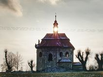 Old chapel with renewal roof on the hill. Old catholic chapel with renewal roof on the hill at Sunset willlow tree wall vibrant travel sunrise summer stone sky royalty free stock images