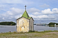 Old chapel on the riverbank Stock Images