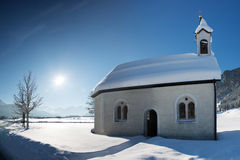 Old chapel in winter snow landscape Royalty Free Stock Images