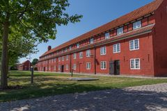 Old charming red building at the old fortress Kastellet, Copenhagen, Denmark Stock Photos