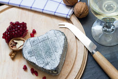 Old cheese in the shape of heart love food concept Stock Photos