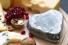 Old cheese in the shape of heart love food concept Stock Photography