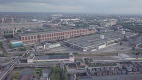 Old chemical factory. With oil storage tank, pipes and refinery workshop, aerial view stock video