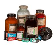 Old chemistry and black-and-white photographic film Stock Image