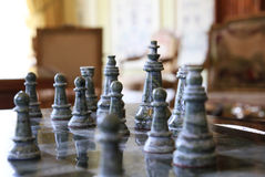 Old chess. Made from stone - focused on the king Royalty Free Stock Image