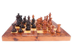 Old Chess Board And Figures. Over white background Royalty Free Stock Images