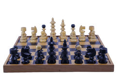 Old chess board with pieces ready to play, isolated Royalty Free Stock Photos