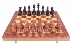 Old Chess board set up to begin a game. Over white Stock Photo
