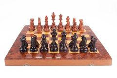 Old Chess board set up to begin a game Royalty Free Stock Image